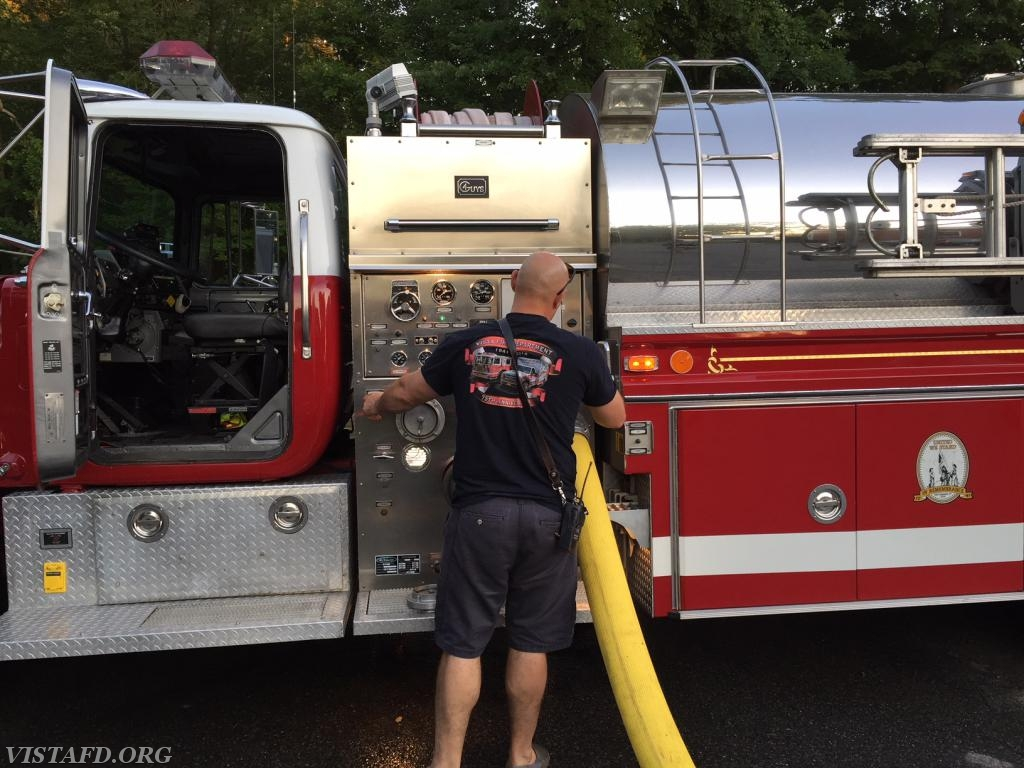 Lead Foreman Marc Baiocco supplying Engine 143 from Tanker 4
