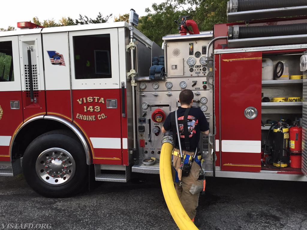 Firefighter Dom Mangone operating the E-143 pump panel