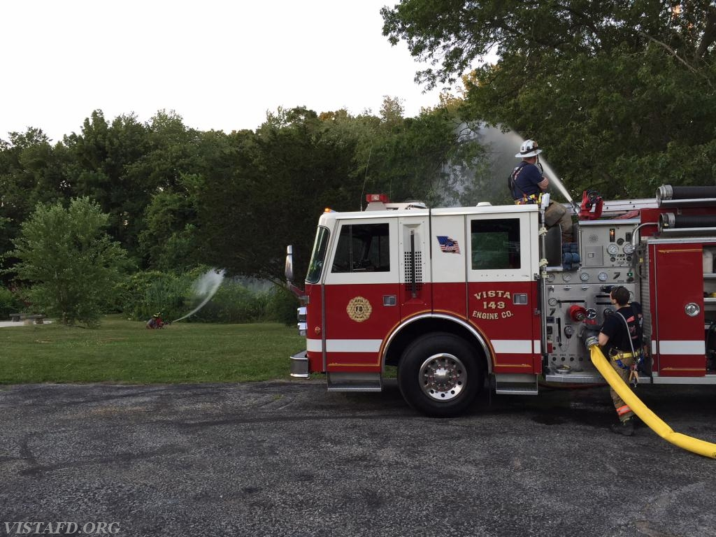 """Engine 143 supplying water to the 1-3/4"""" hose lines"""