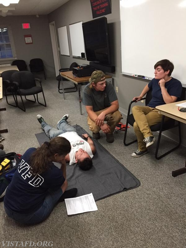 FF/EMT Candidate Patrick Healy practicing how to conduct a trauma practical