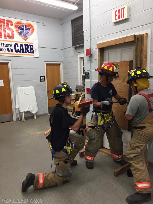 Lt. Phil Katz and Foreman Adam Bartley practicing forcible entry operations
