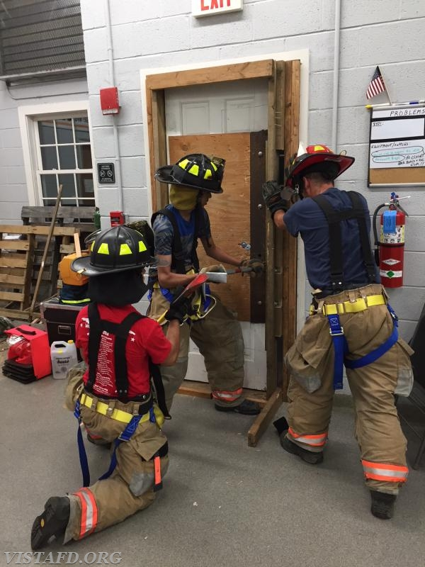 Probationary FF Lance Phillips and Firefighter Adam Ferman practicing forcible entry operations