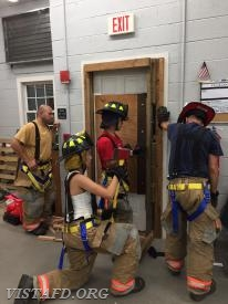 Firefighter Adam Ferman and Firefighter Olivia Buzzeo practicing forcible entry operations