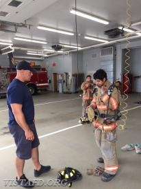 "Lead Foreman Marc Baiocco going over a ""2-minute drill"" during ""Firefighter Fundamentals Class"""
