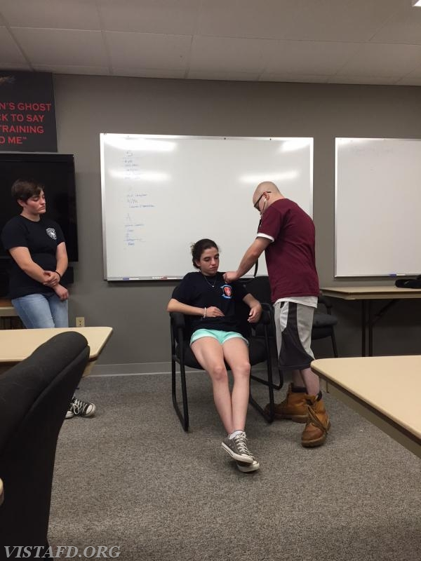 """Firefighter/EMT Candidate Ryan Ruggiero practicing how to take vital signs during """"EMT Fundamentals Class"""""""