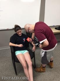 "Firefighter/EMT Candidate Ryan Ruggiero practicing how to take vital signs during ""EMT Fundamentals Class"""