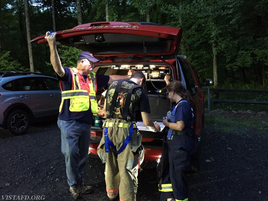 """Ex-Chief Jim Hackett, Capt. Brian Porco & Capt. Debbie Ferman at the command post during the """"Lost Person Search"""" drill"""