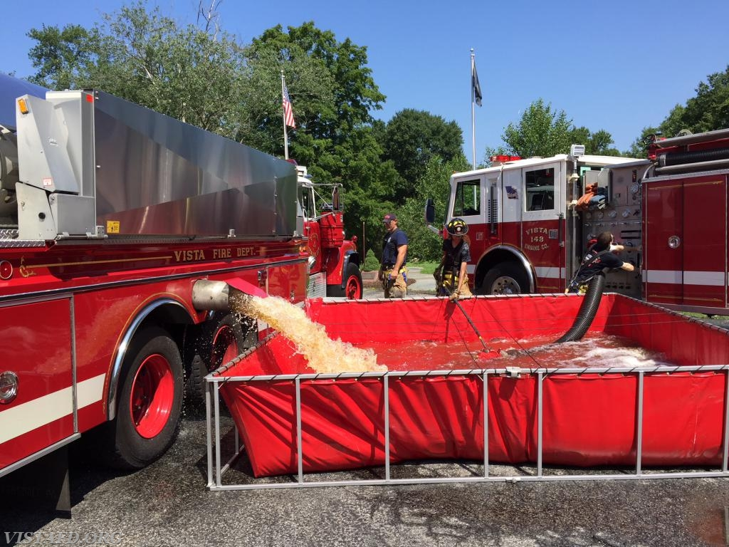 "Tanker 4 dumping water into the portable pond during ""MPO & Firefighter Fundamentals Class"""