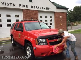 Probationary Firefighter Ethan Haberny cleaning Vista Car 2561