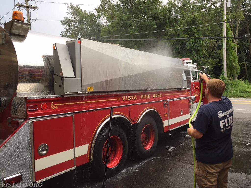 Asst. Chief Mike Peck cleaning Tanker 4