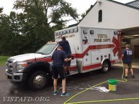 Vista Fire Department members cleaning Ambulance 84B1