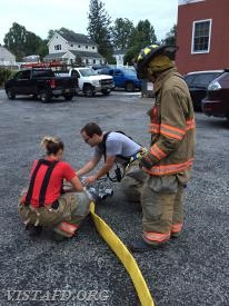 """Capt. Brian Porco going over how to fill a tanker from Engine 142 during """"tanker shuttle"""" operations"""