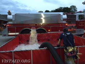 """Vista Tanker 4 dumping water into the portable pond during the """"Tanker Shuttle"""" drill"""