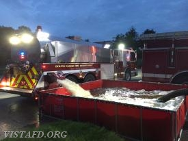 """South Salem Tanker 2 dumping water into the portable pond during the """"Tanker Shuttle"""" drill"""