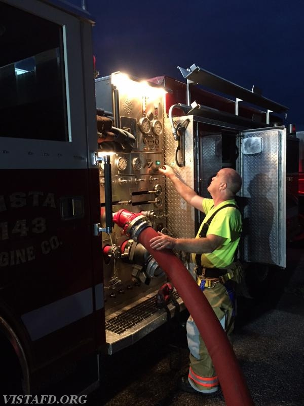 Firefighter Steve Woodstead operating the Engine 143 pump panel