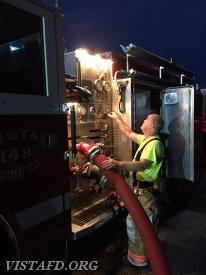 Firefighter Steve Woodstead operating the Engine 143 pump panel