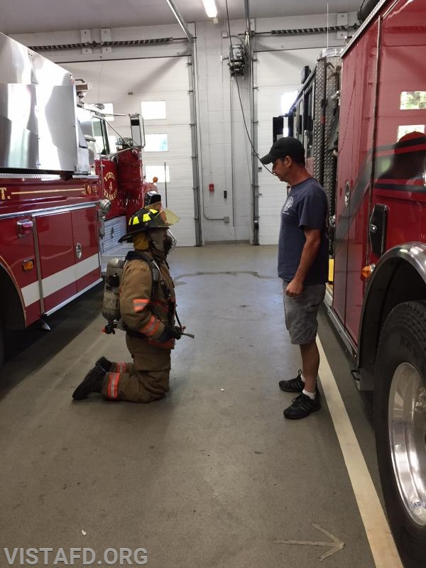 """Lt. Phil Katz going over reduced profile during """"Advanced Firefighter Skills"""" class"""