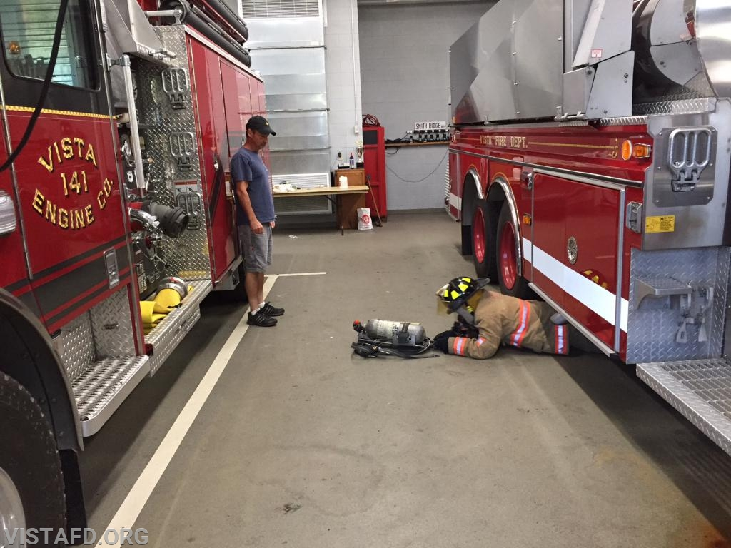 Probationary FF/EMT Candidate Nick Kaplan practicing how to do a full SCBA removal