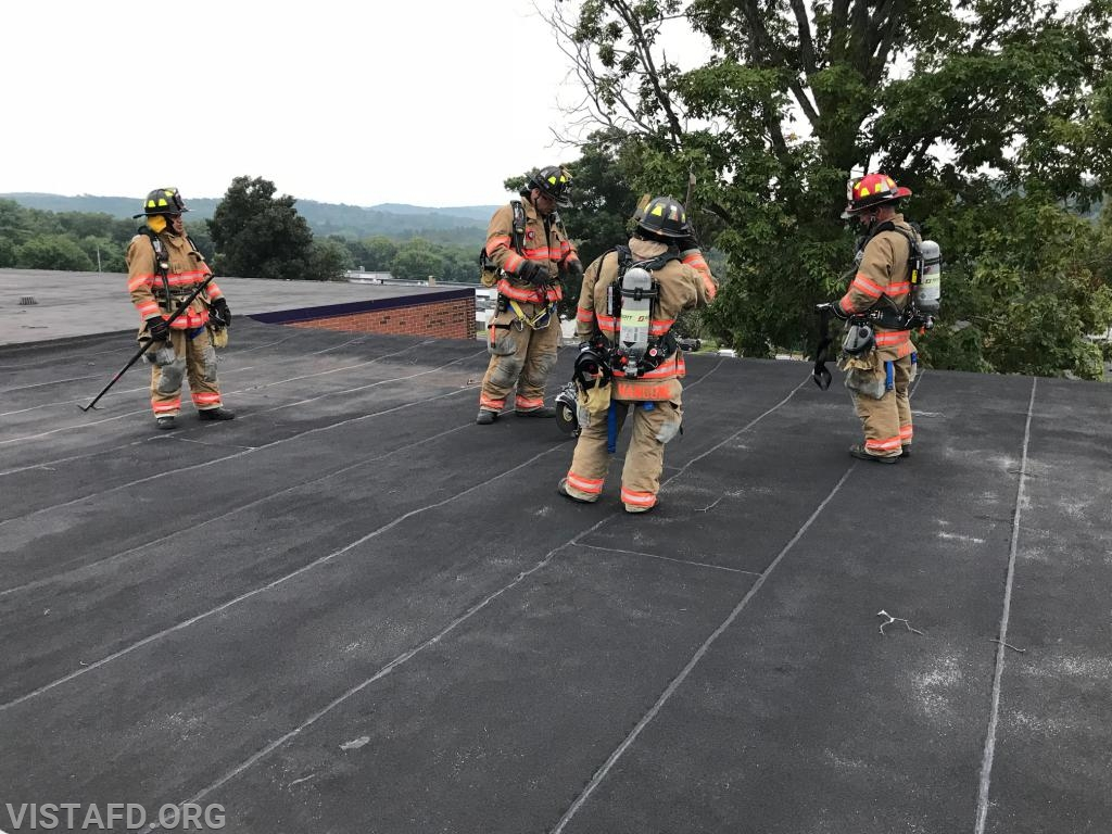 Vista Firefighters on the roof of John Jay High School during ladder operations