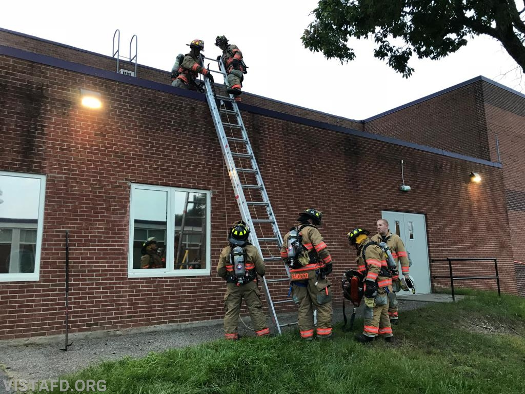 Vista Firefighters performing ladder operations