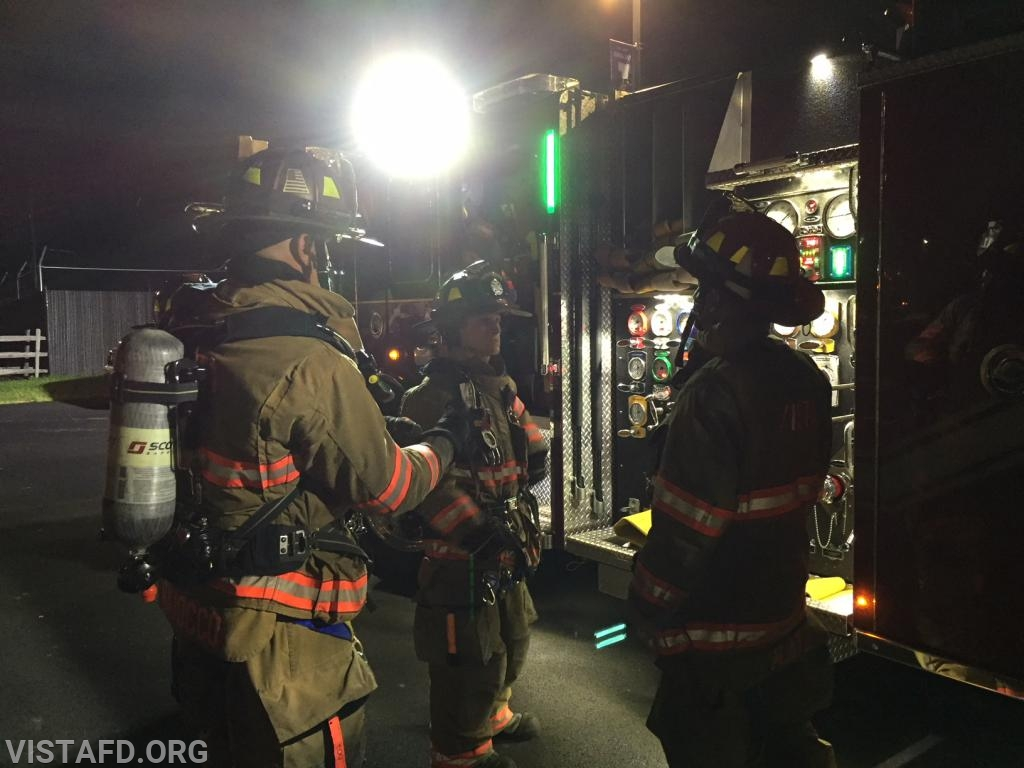 """Vista Firefighters about to stretch the 2-1/2"""" hose line off of Engine 141"""