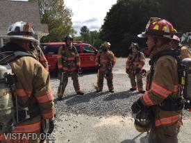Vista Firefighters preparing for the firefighting evolution