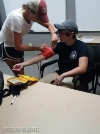 FF/EMT Candidate Olivia Buzzeo practicing how to take a blood pressure