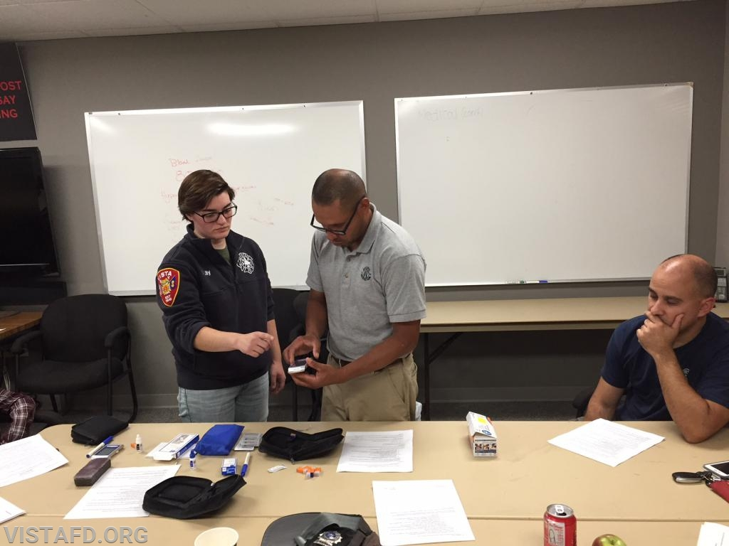 Lt. Wilmer Cervantes practicing how to use the glucometers