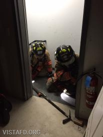 Vista Firefighters going through the search & rescue evolution