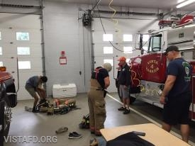 """Vista Firefighters practicing the """"2 minute drill"""" during Firefighter Skills Class"""