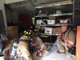Lead Foreman Baiocco reviewing how to enter a smoke filled structure