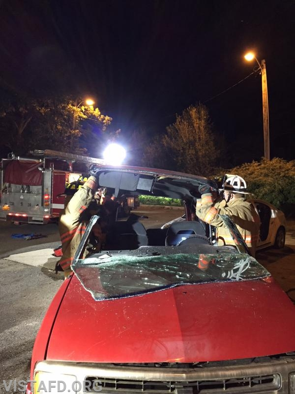 Vista Firefighters practicing how to do a roof removal