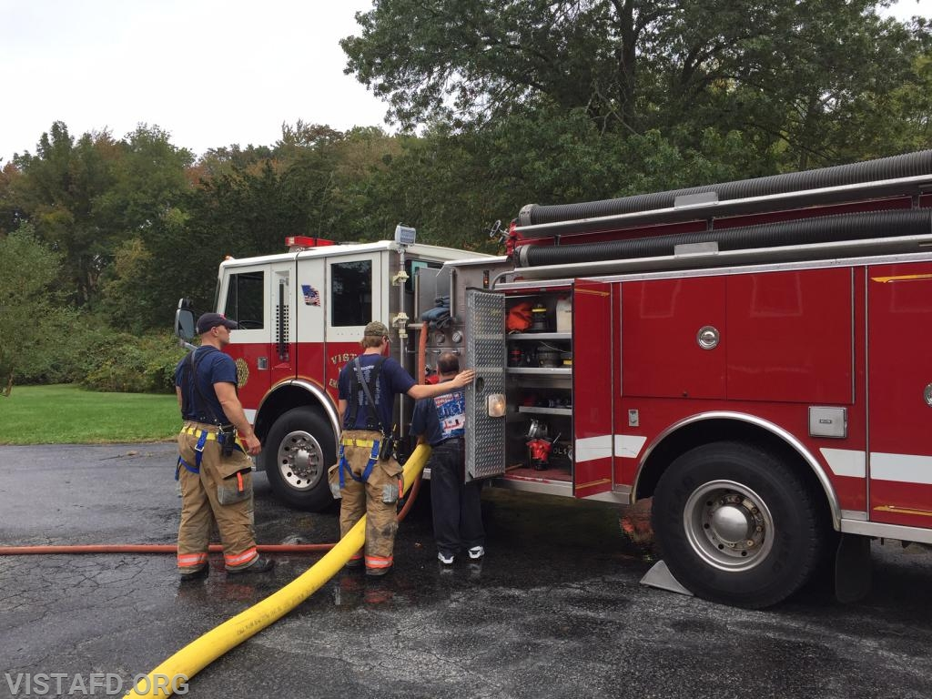 FF Patrick Healy practicing pumping Engine 143 as Lead Foreman Marc Baiocco & Mutual Responder Dave Jacobsen look on