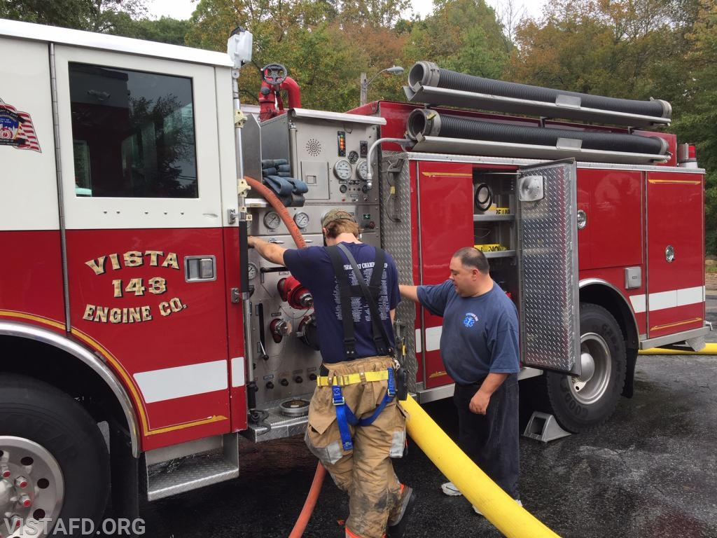 FF Patrick Healy practicing pumping Engine 143 as Mutual Responder Dave Jacobsen looks on