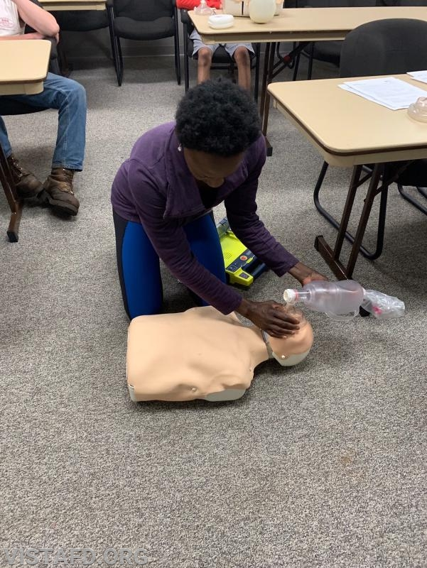 Probationary EMT Candidate Judith Le Gall performing CPR during the AHA CPR Class