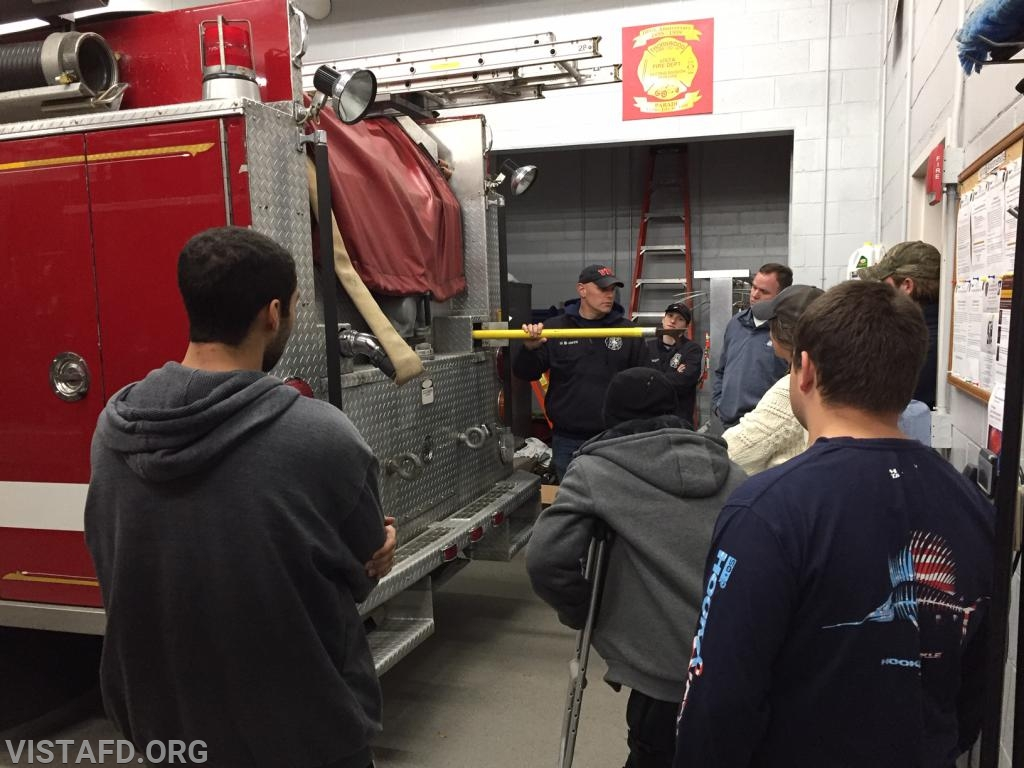 Lead Foreman Marc Baiocco going over the equipment on Engine 143