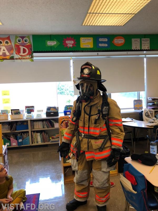Firefighter Adam Ferman showing off his Firefighting gear to the MPES students