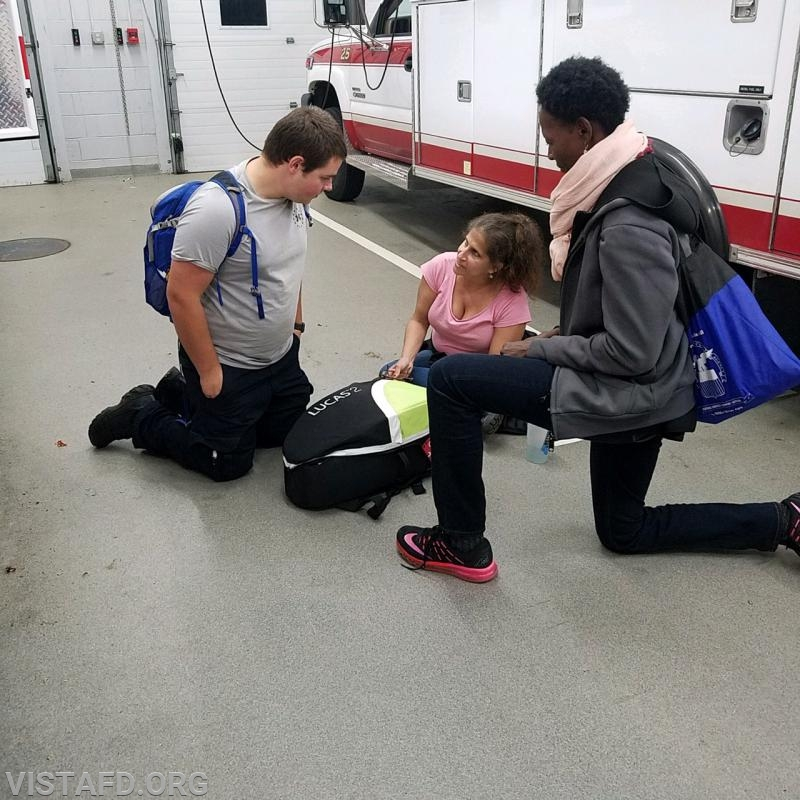 Capt. Debbie Ferman going over how to use EMS equipment with Vista EMS personnel