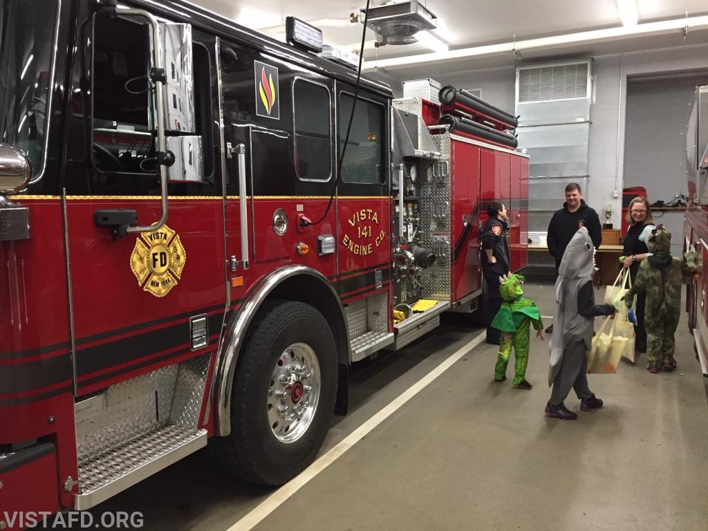 Firefighter Dom Mangone giving tours of Engine 141 during our 2018 Community Halloween Party