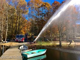 "Vista Engine 141 flowing water at the Lake Kitchawan dry hydrant during ""MPO & Firefighter Skills Class"""