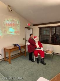 Santa Claus greeting members of the community from the Vista Fire District