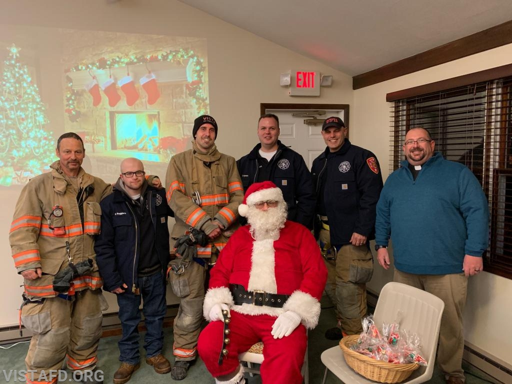 "The Vista Fire Department with Santa Claus and Pastor Mike Barry at the 2018 Stevens UMC ""Christmas For All Event"""