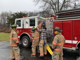 "Foreman Pat Healy reviewing how to stretch an 1-3/4"" hose line off of Engine 143"