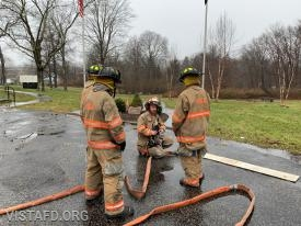 "Lt. Phil Katz going over how to operate an 1-3/4"" hose line"