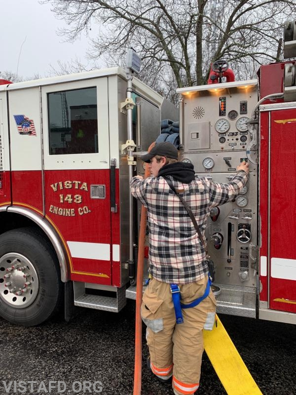 Foreman Pat Healy operating the Engine 143 pump panel