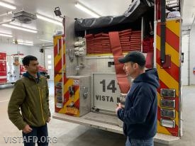 Lt. Phil Katz going over Engine 141 with Probationary Firefighter Lance Phillips