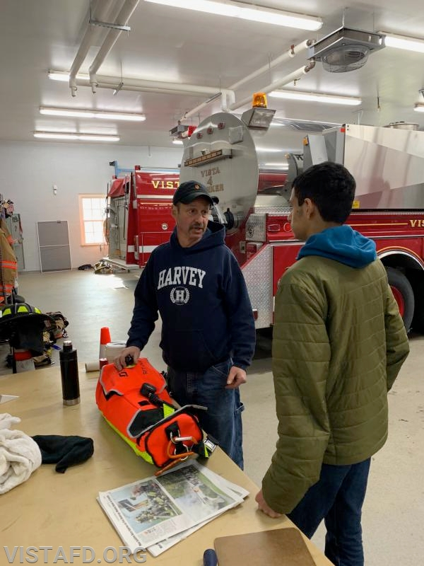 Lt. Phil Katz going over the R.I.T. pack off of Engine 141 with Probationary Firefighter Lance Phillips