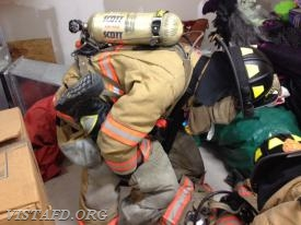 FF Phil Katz prepares to remove the trapped Firefighter from the room during F.A.S.T. training