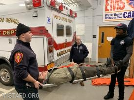 Foreman Mike Canil going over how to use the scoop stretcher