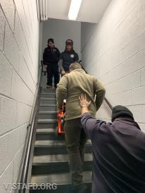 Vista EMS personnel practicing how to operate the stair chair